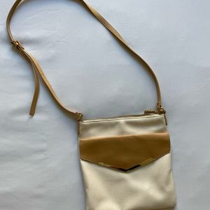 Charming Charlies *perfect condition*cream satchel